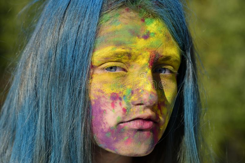 Fashion youth party. Optimist. Spring vibes. Crazy hipster girl. Summer weather. colorful neon paint makeup. child with. Body art. celebrating holi and playing royalty free stock photo
