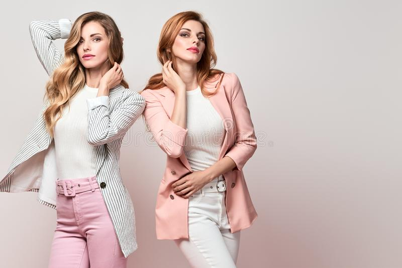 Two Fashion autumn woman, Trendy hair, fall outfit royalty free stock image