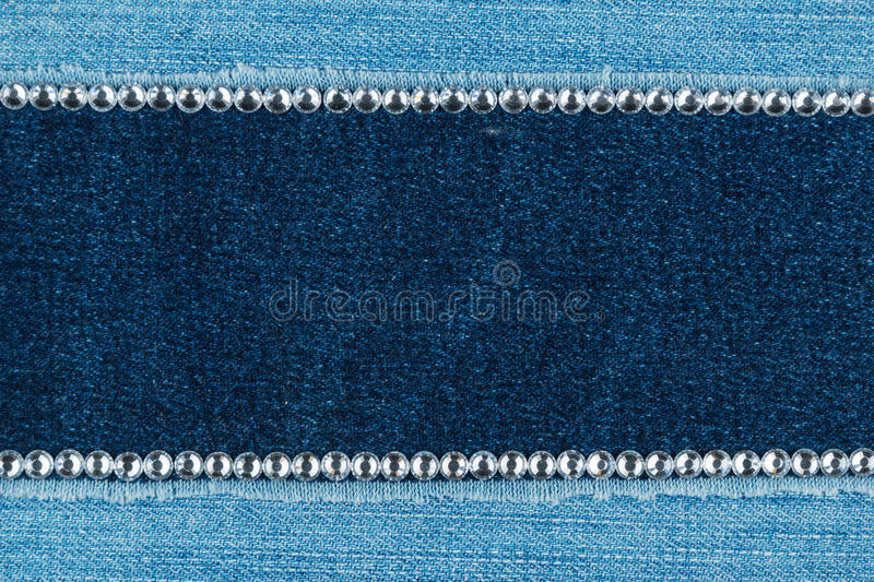 Fashionable background, jeans and silver rhinestones stock photo