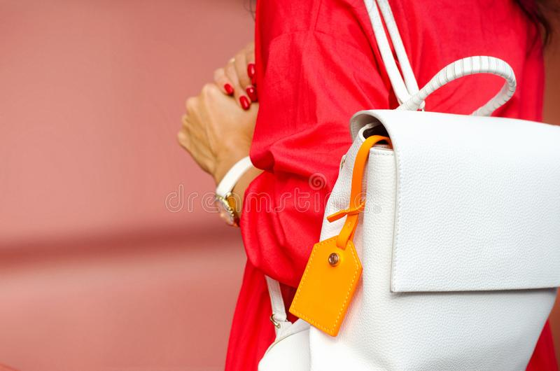 Fashionable bag close-up in female hands.Girl walks in the city outdoors. Stylish modern and feminine image, style. stock photography