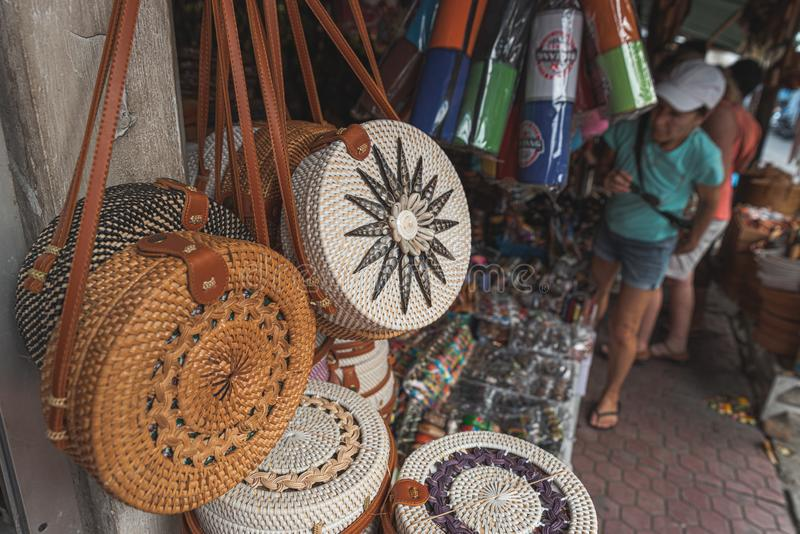 Fashionable bali round rattan bag with long strap, straw bag royalty free stock images