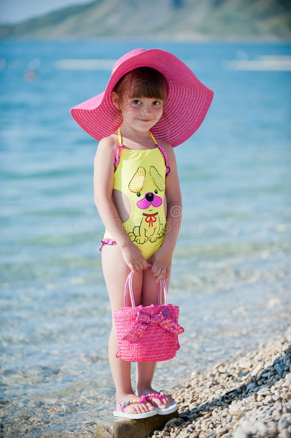 Fashionable on the beach stock photos