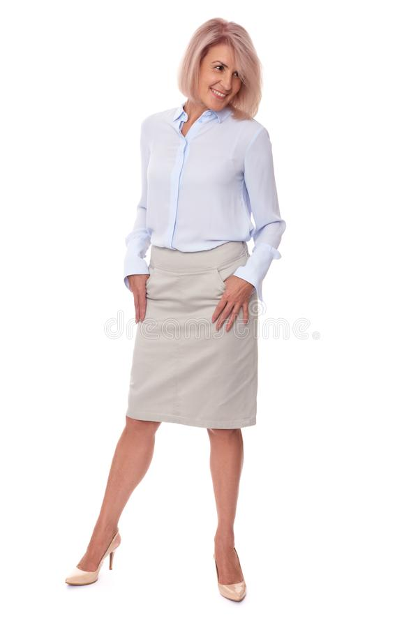 Beautiful middle aged woman. Full body portrait. Fashionable beautiful middle aged woman isolated on white. Full body portrait stock photo