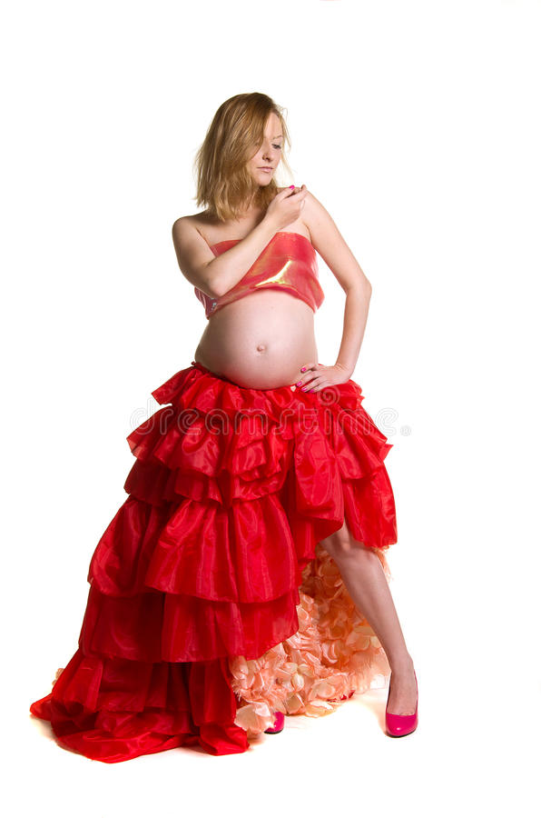 Fashionable beautiful pregnant in luxurious skirt stock image