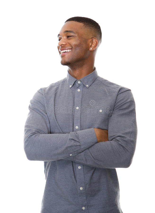 Fashionable black guy smiling with arms crossed. Portrait of a fashionable black guy smiling with arms crossed on isolated white background royalty free stock photo