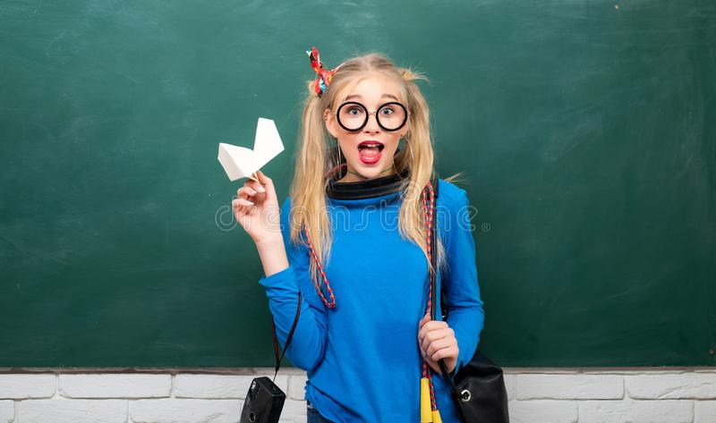 Fashionable blonde girl chalkboard background. Back to school. Stylish school pupil modern girl. Cute female funky style stock photos