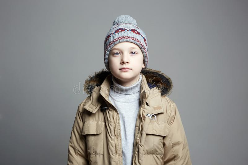 Fashionable Boy in winter outerwear. fashion kid royalty free stock photography