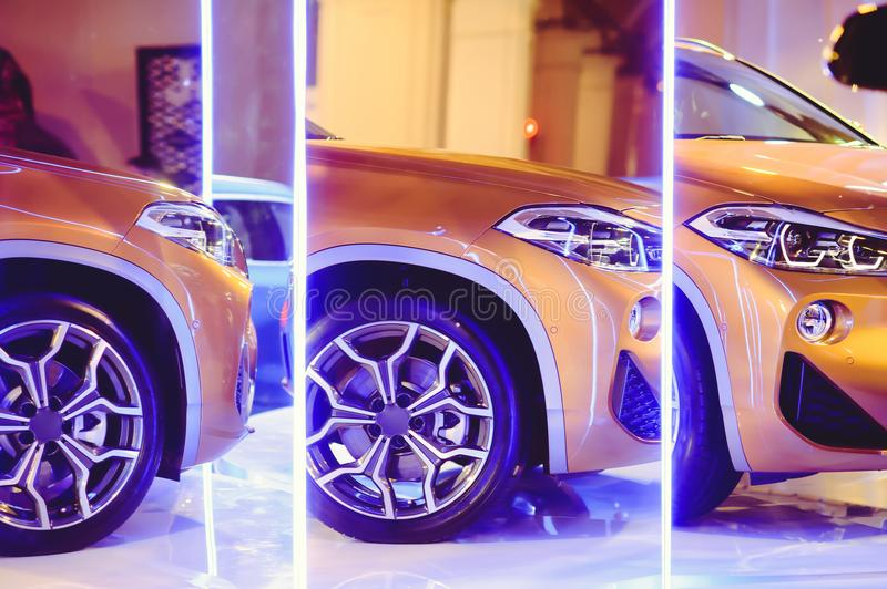 Fashionable bright auto show A number of new cars parked in the car dealers` warehouse, modern design of the room with mirrors stock image
