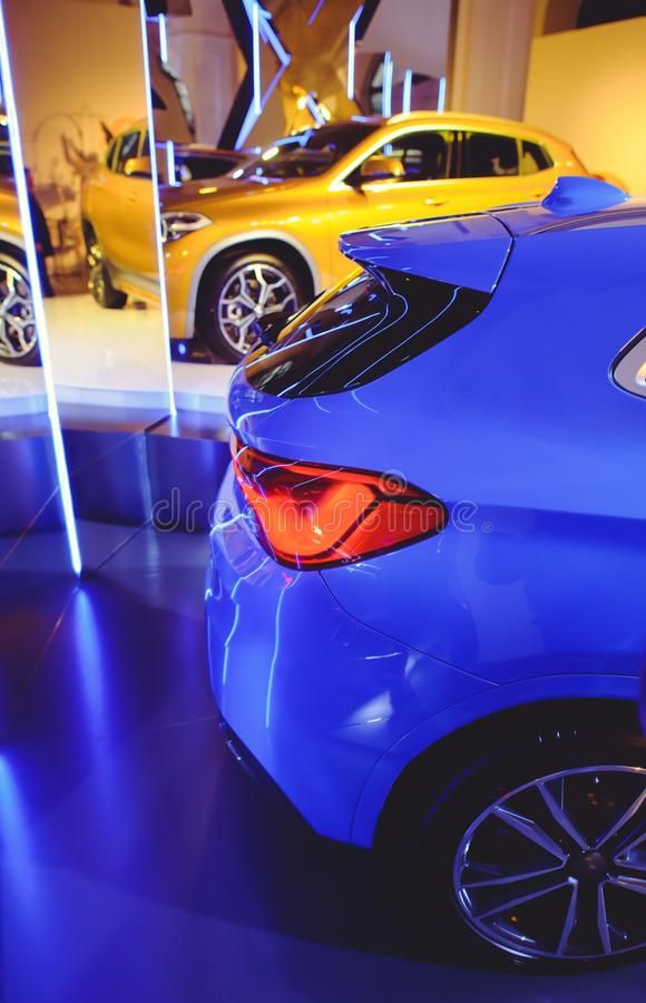 Fashionable bright auto show A number of new cars parked in the car dealers` warehouse, modern design of the room with mirrors stock photo