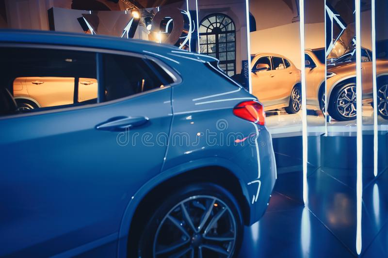 Fashionable bright auto show A number of new cars parked in the car dealers` warehouse, modern design of the room with mirrors.  royalty free stock images