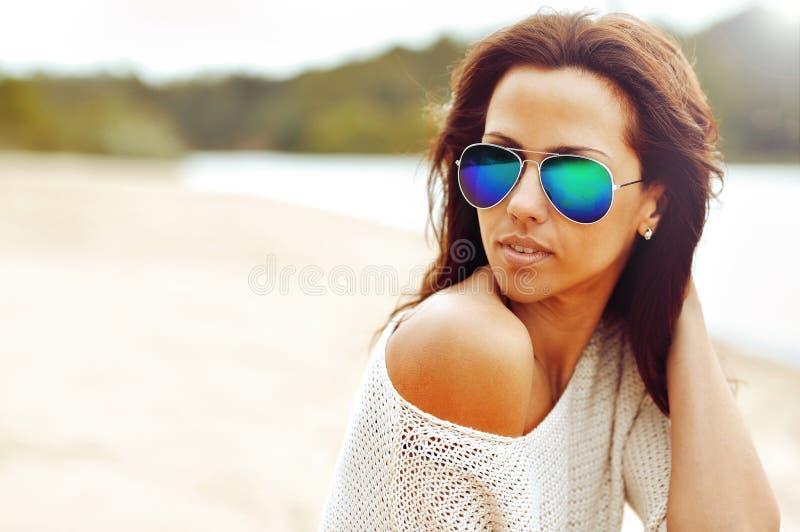 Fashionable brunette woman portrait in sunglasses - closeup. Fashionable brunette woman portrait in sunglasses - close up stock photos