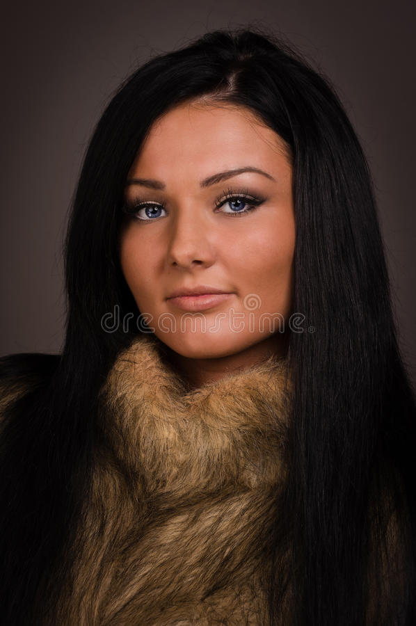 Fashionable brunette women stock image