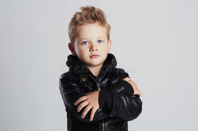 Fashionable child in leather coat.little boy hairstyle stock images