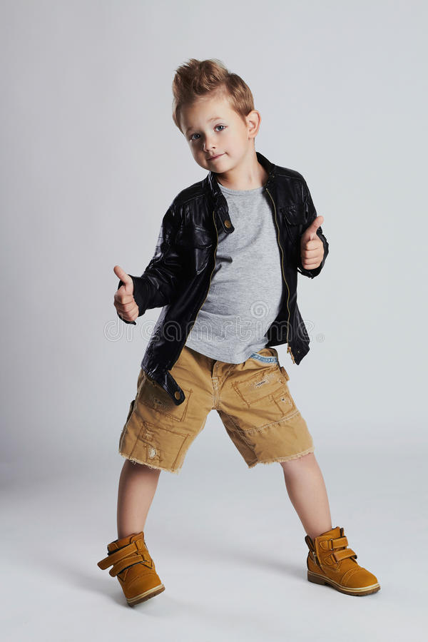 Fashionable child in leather coat.little boy hairstyle. Autumn fashion royalty free stock photography