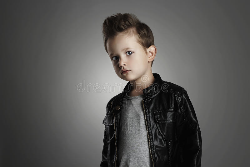 Fashionable child in leather coat.stylish little boy. Autumn fashion stock photo