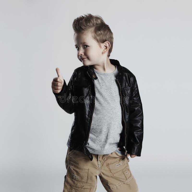 Fashionable child in leather coat.stylish little boy. Autumn fashion stock image