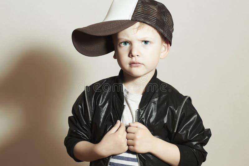 Fashionable Child.stylish little boy in tracker Cap.fashion children royalty free stock photo