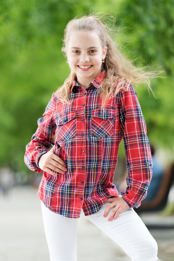 Fashionable clothes that make you feel good. Happy little child wearing fashionable plaid shirt. Fashionable look of. Small vogue model. Adorable fashionable stock photos