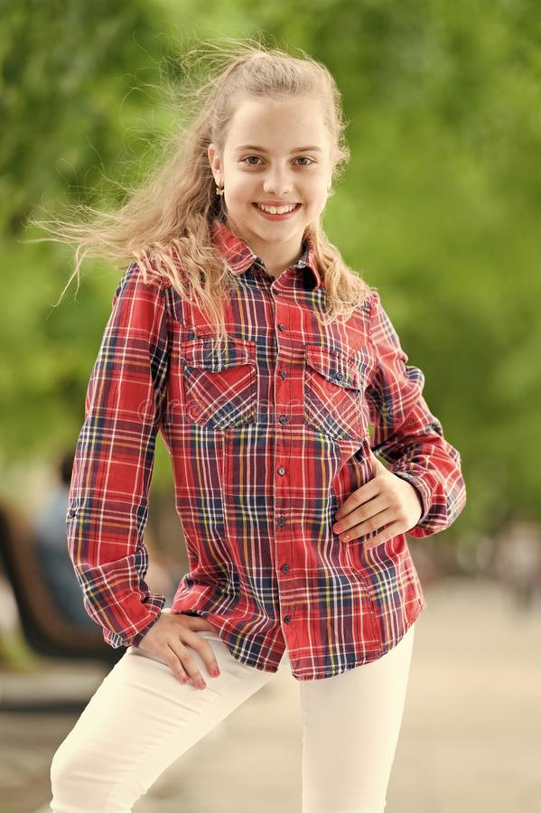 Fashionable clothes that make you feel good. Happy little child wearing fashionable plaid shirt. Fashionable look of royalty free stock photo
