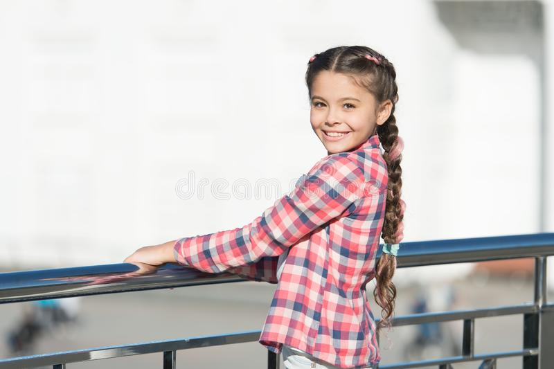 Fashionable clothes that make you feel relaxed. Happy small girl wearing fashionable plaid shirt. Fashionable look of. Little vogue model. Adorable fashionable stock photos