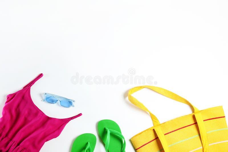 Fashionable clothing set lying on white background royalty free stock images