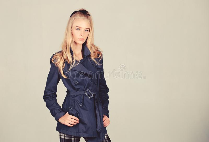 Fashionable coat. Woman makeup face blonde hair posing coat with collar. Clothes and accessory. Girl fashion model wear. Coat for spring and autumn season royalty free stock photo