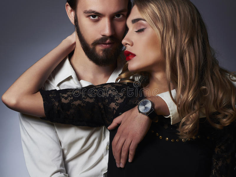 Fashionable couple. Beautiful woman near the man. Luxury fashionable couple. Beautiful women near the man.beauty girl and boy together stock images