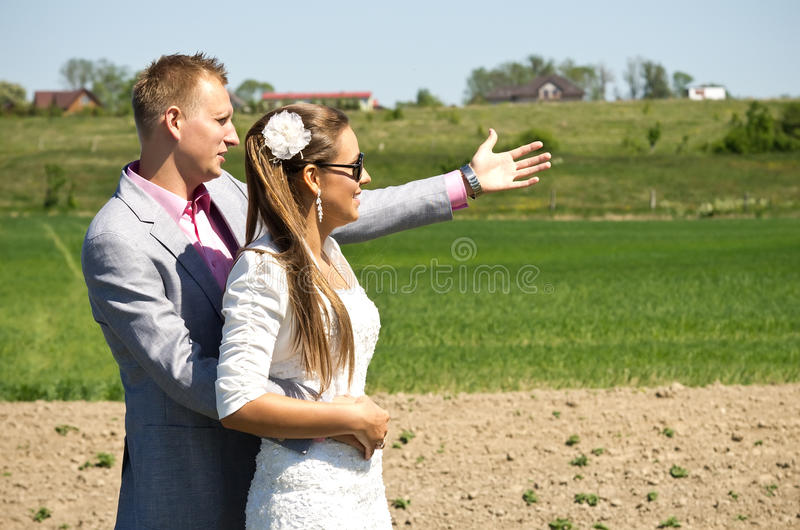 Fashionable couple in country royalty free stock photography