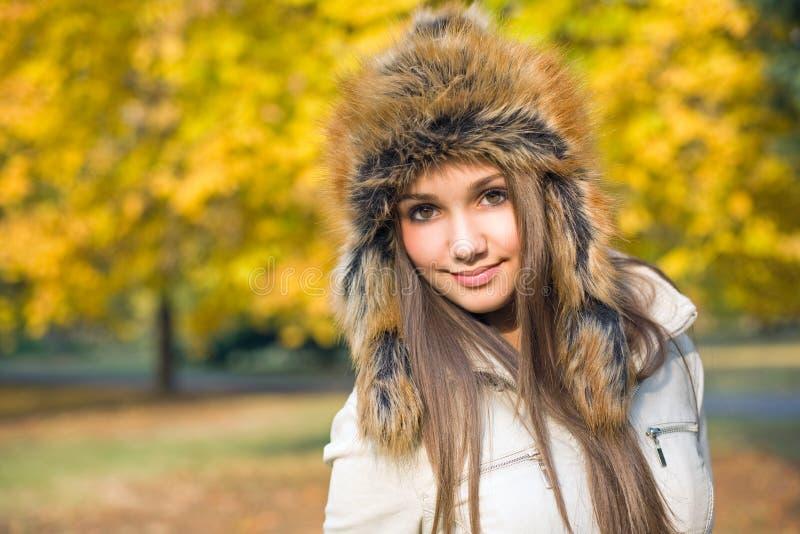 Fashionable cute brunette girl stock photos