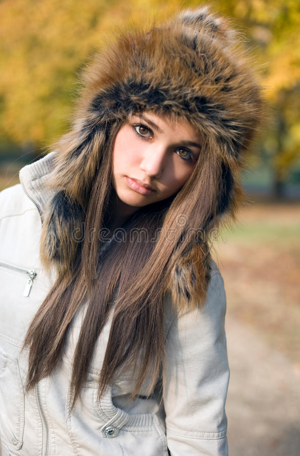 Fashionable cute brunette girl with seriuos look. stock images