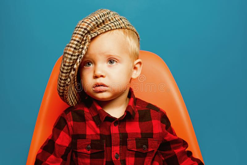 Fashionable cutie. Boy child with fashion look. Small child. Small baby in fashionable wear. Fashion boy. Adorable royalty free stock image