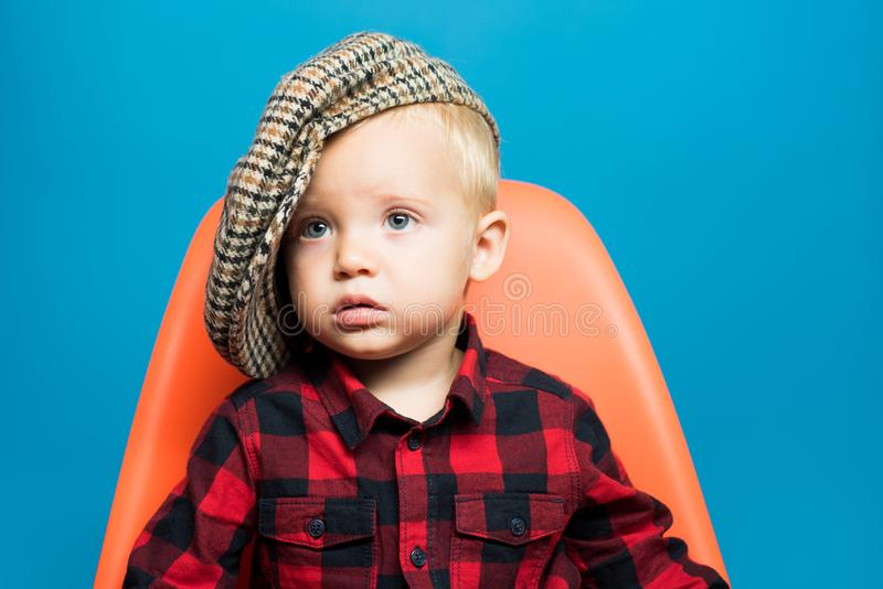 Fashionable cutie. Boy child with fashion look. Small child. Small baby in fashionable wear. Fashion boy. Adorable stock photography