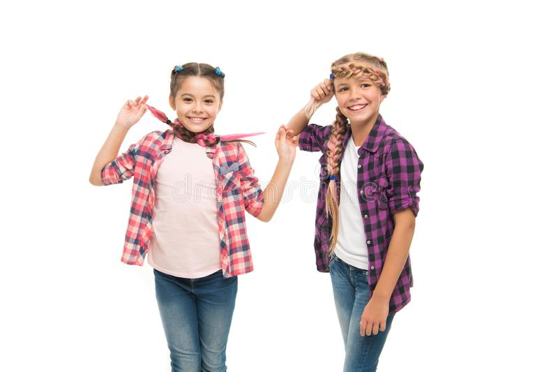 Fashionable cutie. Happy childhood. Keep hair braided. Sisters with long braided hair. Hairdresser salon. Having fun royalty free stock image