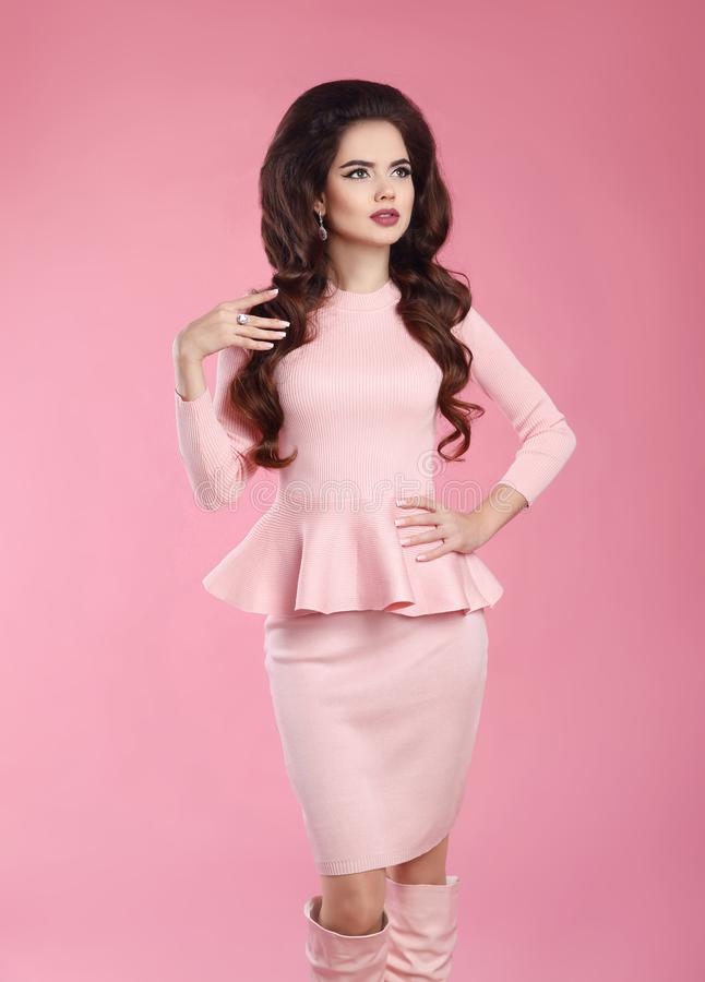 Fashionable dressed woman in pink dress. Young beautiful gorgeous female model posing isoated on studio background. Three royalty free stock image