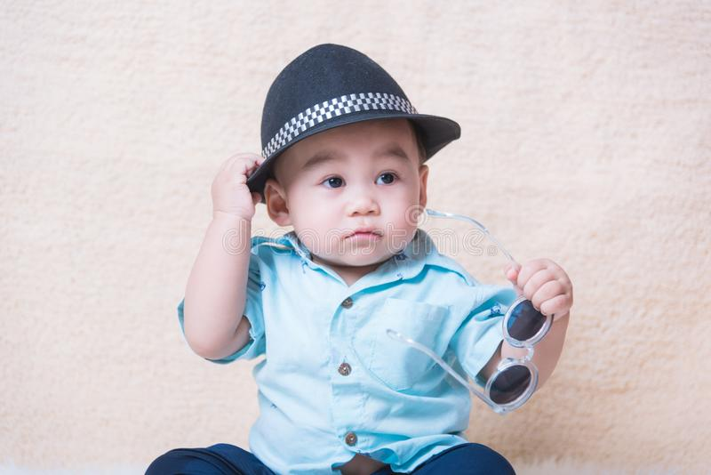 Fashionable funny child baby boy. With sunglasses royalty free stock photography