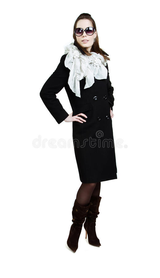 Fashionable girl in an autumn coat royalty free stock photo