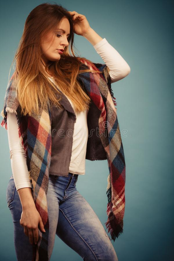 Fashionable girl in autumn warm clothing royalty free stock photo