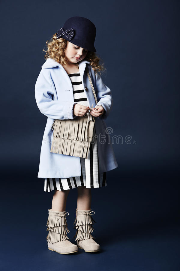 Fashionable girl in blue with bag royalty free stock photo