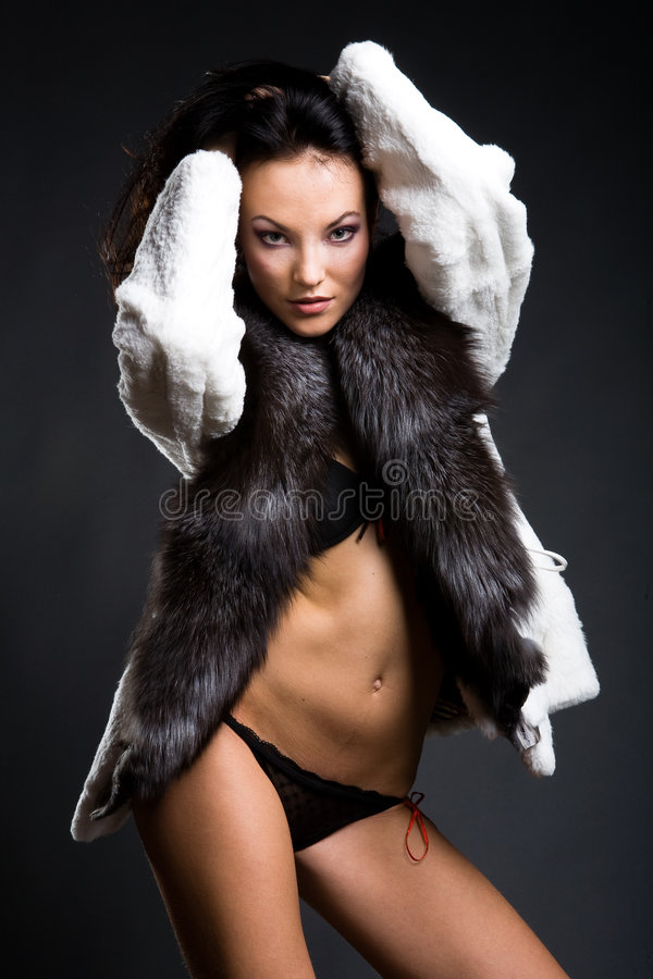 Fashionable girl in fur royalty free stock photo