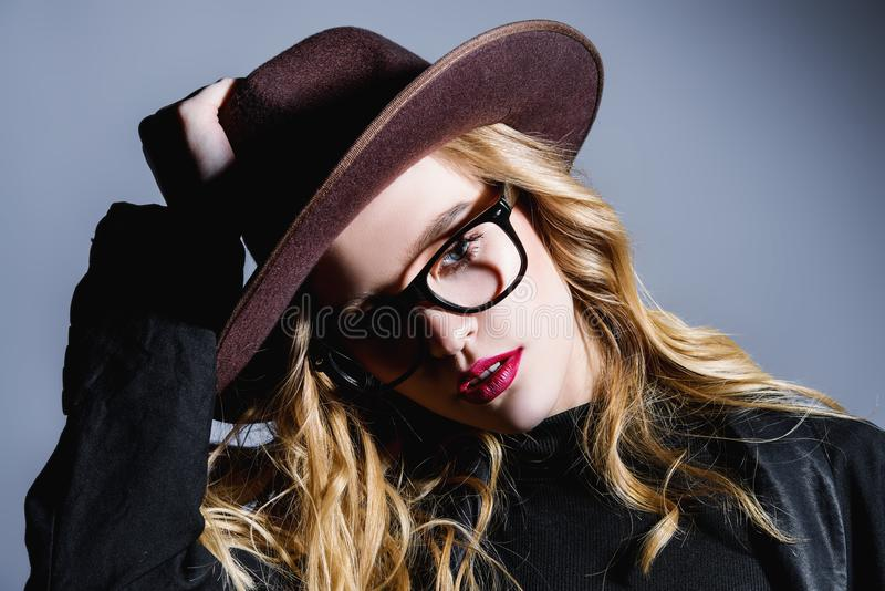 Fashionable girl in hat stock photography