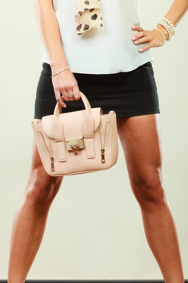 Fashionable girl holding bag handbag royalty free stock photo