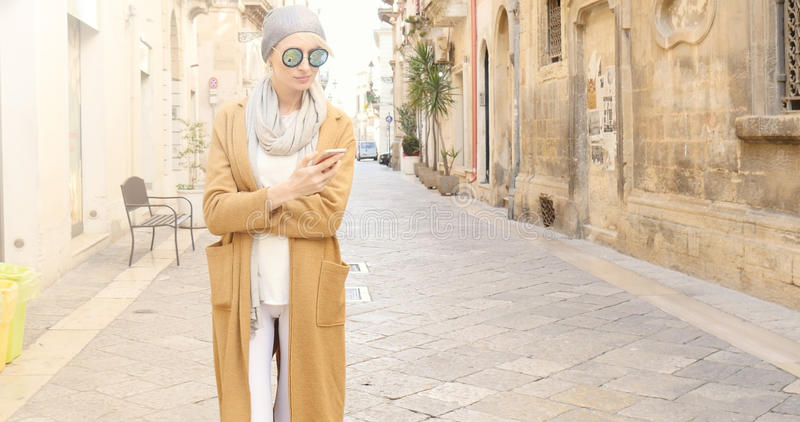 Fashionable girl with mobile phone. stock photo