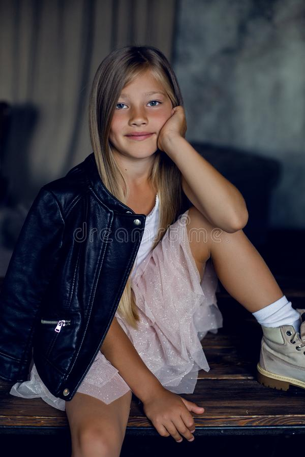 Fashionable girl model in a leather jacket skirt and shoes royalty free stock photos