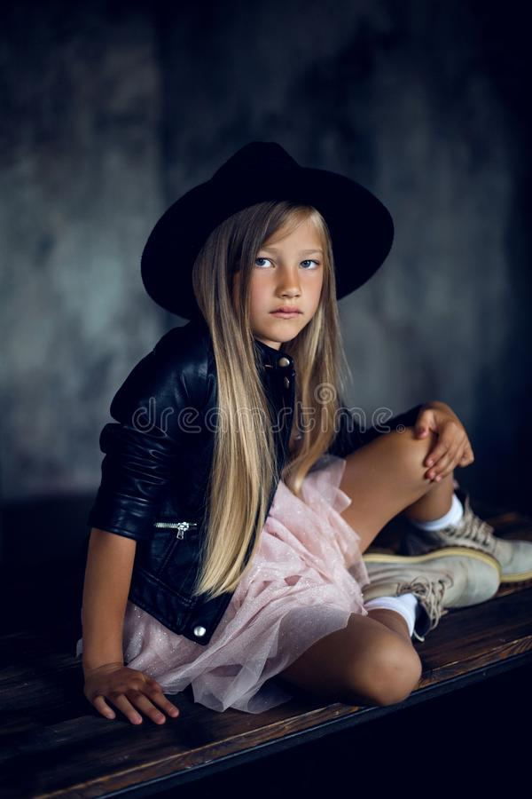 Fashionable girl model in a leather jacket skirt and shoes stock image