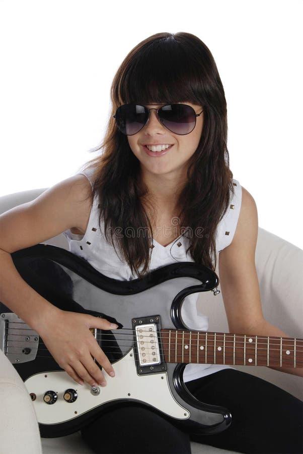Fashionable girl playing electric guitar stock photos