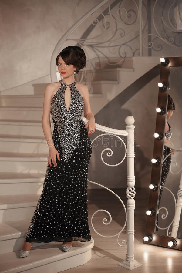 Fashionable girl student at graduation prom party. Brunette with stock photography