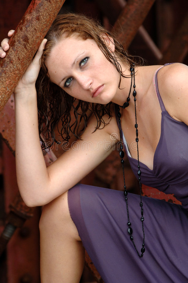 Fashionable girl with wet hair. A beautiful girl with wet hair wearing a party dress and necklace stock photography