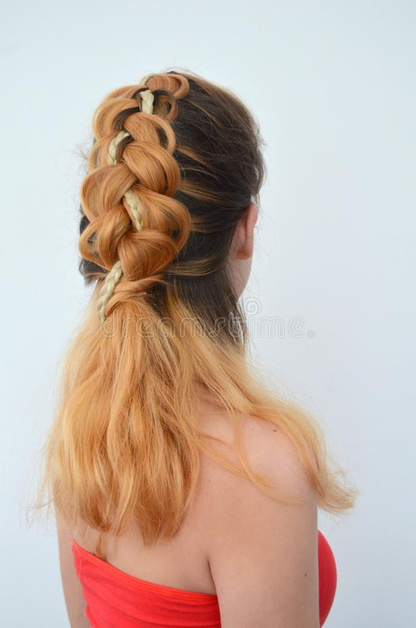 Mastery of weaving from hair with long length of hair royalty free stock photo