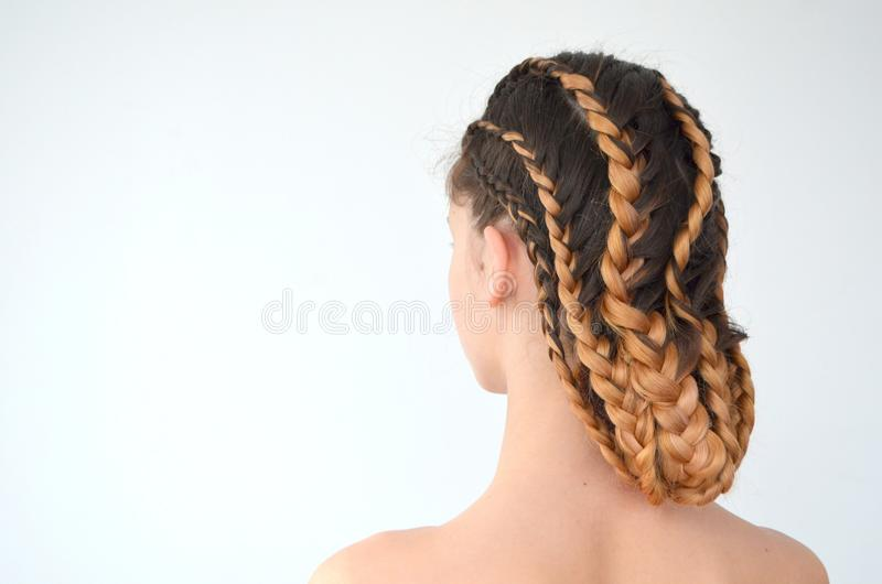Mastery of weaving from hair with long length of hair royalty free stock image