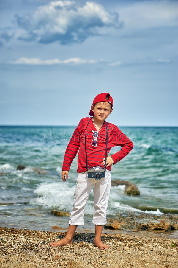 Fashionable handsome boy on the sea coast . royalty free stock photos